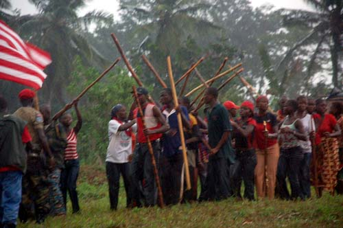 Residents of River Gee County await President Sirleaf's arrival, despite the heavy downpour of rain.