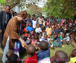 A cross-section of children meet with President Sirleaf at the party.