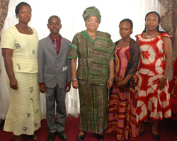 Scholarship students pose in a photo with President Sirleaf.