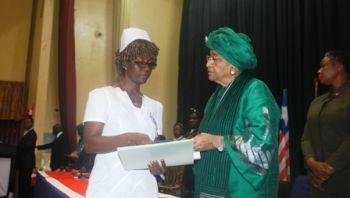 A nurse and survivor, Ms. Barbara Bono is honored by President Sirleaf admitted into the Order of the Star of Africa, with the Grade of Commander.