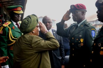 After being fully attired, Brig. Gen Ziankhan salutes C-i-C Sirleaf during programs marking Armed Forces Day 2014.