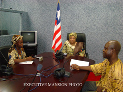 President Ellen Johnson Sirleaf, Press Secretary Cyrus Badio, and one of the Executive Mansion reporters.