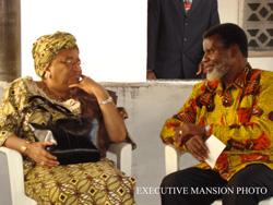 President Sirleaf and Oscar Quiah in a chat.