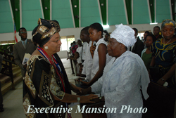 President Sirleaf and the wife of the late Jackson F. Doe.