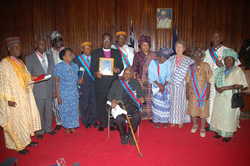 The honorees and President Sirleaf pose for a photo at the Foreign Ministry in Monrovia.