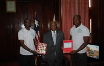 Vice President Joseph N. Boakai with Greatest Stationery and Office Supply staffs during the presentation of the school composition books