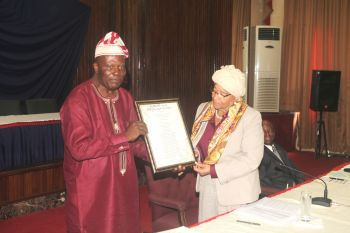 Dr. Tipoteh presents President a special 78th birthday gift during Cabinet Meeting.