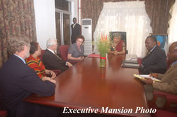 Dr. Thomas Corts and members of his delegation in a meeting with President Sirleaf.
