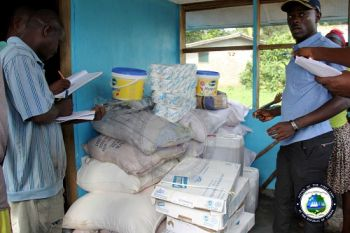 Administrative Assistant, James Kortu Suakoko donating food items to the Leprosy Rehabilitation Center in Bong County