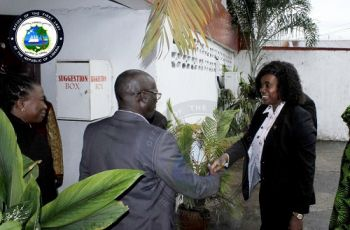 First Lady Weah in a hand shake with LNRCS President Mr. Jerome Clark at the LNRCS Headquarters, Aug