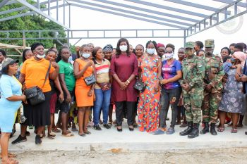 Flanked by wives of AFL soldiers along with ranking army personnel, Mrs. Weah is delighted with the vocational training center project, Jan. 5, 2021