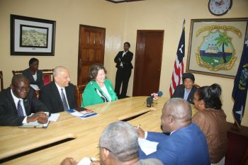 Friendly exchanges during President Sirleaf's meeting with the CEO of Carter Center at the Office of the President.