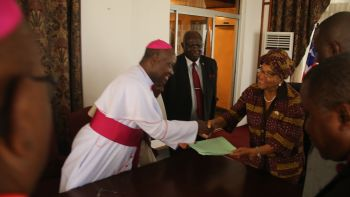 His Grace Archbishop Ignatius Kiagama presents Special Statement to President Sirleaf.