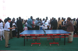 President Sirleaf plays tennis with Chinese Ambassador  Zhou Yuxiao at the newly opened SKD Sports Complex.