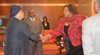 Liberia's Ambassador to China, McKinley Thomas introduces President Sirleaf to a female colleague in Beijing, China.j