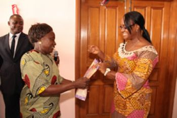 Madam Fatu Morris on behalf of MOS employees presents gifts to Mrs Richardson.