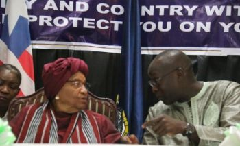 Minister Konneh chats with President Sirleaf.
