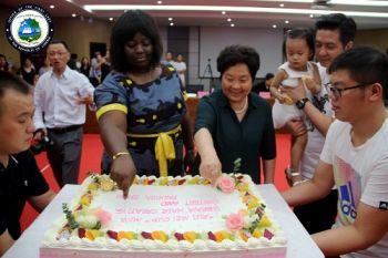 Miss Najet Akar, Proxy of the First Lady, stands alongside Madam Zhang at the closed of the 30 Liberian girls training program, Henan Ruimei Hair Comp