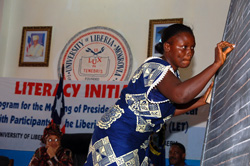 Adult Literacy Participants display skills as President Sirleaf marvels at progress