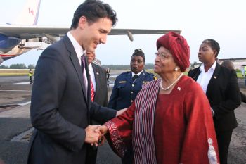 PM Trudeau being welcomed by President Sirleaf.