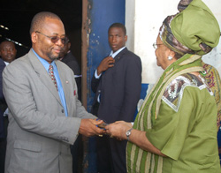 N.P.A. Board Chairman Dr. William Allen presents the keys to President Sirleaf.