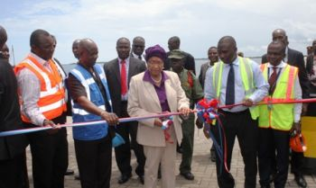 President  Sirleaf cutting ribbon at the Aids to  Navigation and Contingency Fuel Unloading Facility in the Freeport of  Monrovia.