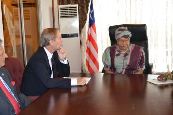 President Sirleaf  chats  with Mr.  Olof Skoog, Vice Chairman of the United Nations Peace Building Commission.
