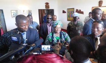 President Sirleaf addresses journalists upon arrival from Abidjan on Wednesday, May 27, 2015.