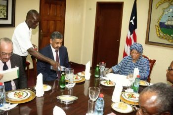 President Sirleaf and Dr. Sidi Ould Tah of the Arab Bank during the Working Lunch.