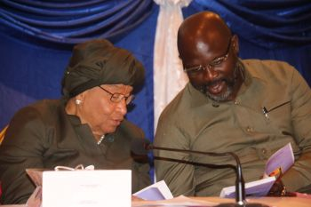President Sirleaf and President-Elect George Weah compare notes during Legacy Project