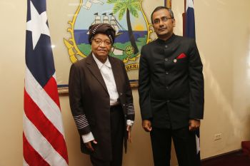 President Sirleaf and new Indian Ambassador R. Ravindra  pose for photo.