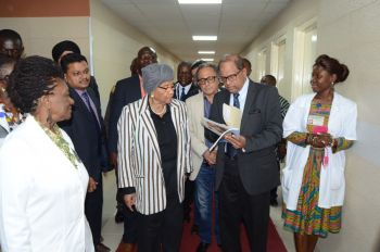 President Sirleaf being briefed by Eye Doctors upon  arrival at the Eye Center in the JFK compound.