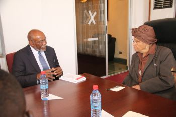 President Sirleaf chats with    Ambassador Carson.