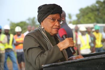 President Sirleaf cuts ribbon during dedication of the newly constructed Stockton Creek bridge in Monrovia.