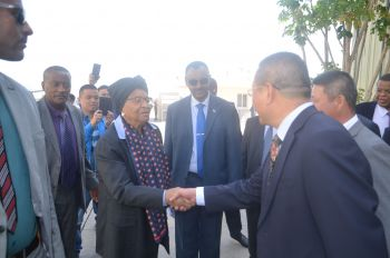 President Sirleaf greets senior executives of Eastern Industry Zone.