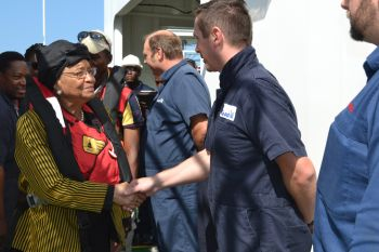President Sirleaf in a handshake with staff on the Rig.