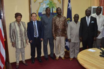 President Sirleaf in group photo  with representatives of TIDFORE and senior government officials.