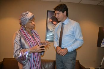 President Sirleaf makes a point to Prime Minister Trudeau of Canada at a brief meeting in New York