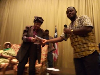 President Sirleaf receives copy of movie from John Kenyon.