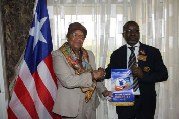 President Sirleaf receives gift  from  Governor Adediran.