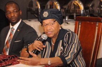 President Sirleaf speaking during meeting with development partners recently at Mamba Point Hotel.