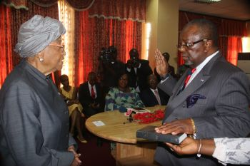 President Sirleaf swears-in Ambassador Richelieu A. Williams.