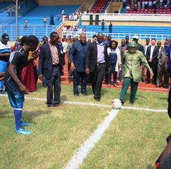 President Sirleaf takes kick off following the cutting of the ribbon at the SKD.