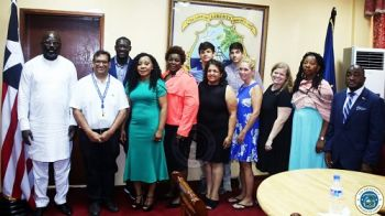President Weah and other government officials pose with visiting US Doctors