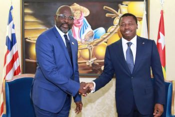 President Weah in a Handshake with his Togolese Counterpart, Faure Gnassingbe.jpg