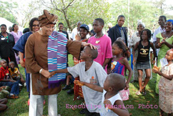 President Sirleaf shares fun moments with the Children at Christmas party