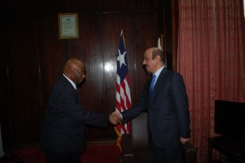 VP Boakai shakes hands with out-going Chinese Ambassador.