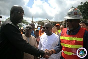 President Weah shakes hands with Mr. Claude Langley, Deputy Minister for Technical Services, Ministry of Public Works