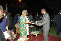 Deputy Foreign Minister for Administration Marcus Dahn presents a Christmas Card to President Sirleaf on behalf of the Cabinet.