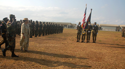 President Sirleaf inspects the troops.
